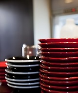 Stack of red plates and white plates